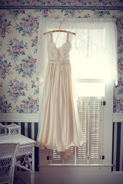 Bride-Gown-Hanging-in-Blue-Room