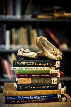 ballet-flats-on-stacked-books