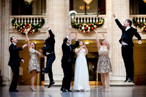 bridal-party-throwing-flowers-in-the-air