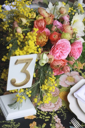 Pink-and-Yellow-Ranunculus-Rose-Fern-Centerpiece