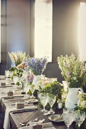 Colorful-Centerpieces-in-White-Pitcher-Vases