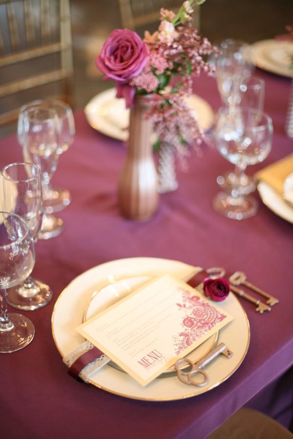purple gold wedding centerpiece