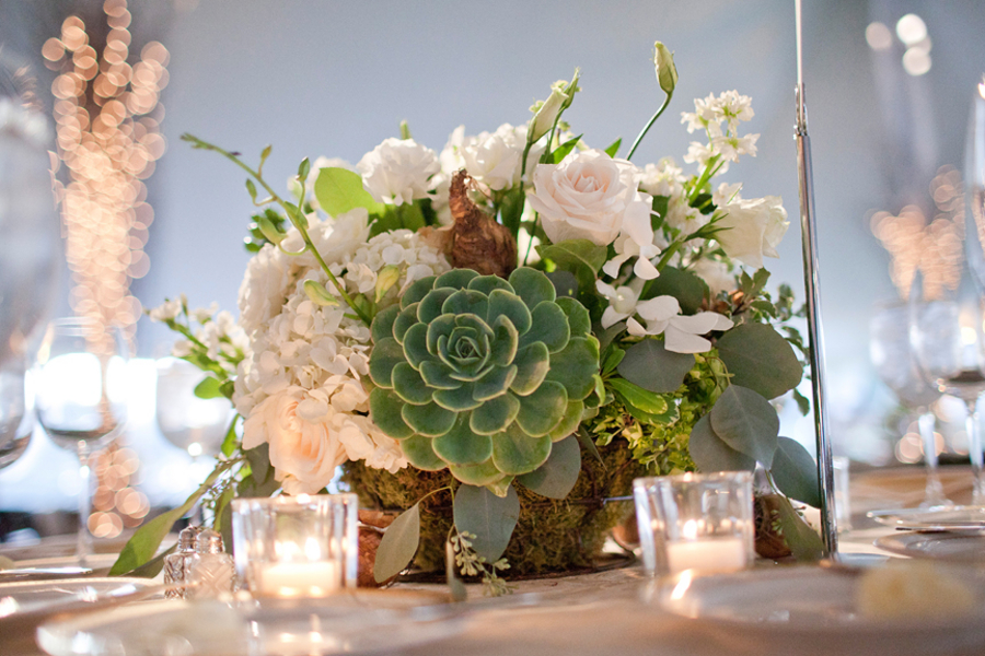Green and white wedding centerpiece with succulent