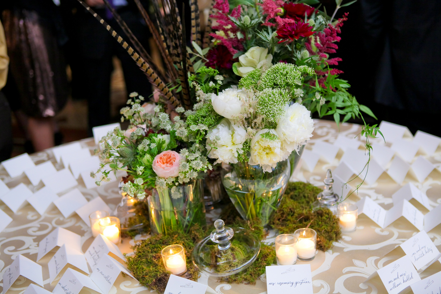 Pheasant feather and moss woodsy wedding centerpiece