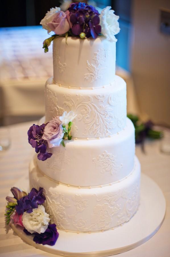 Elegant White Wedding Cake With Purple Flowers