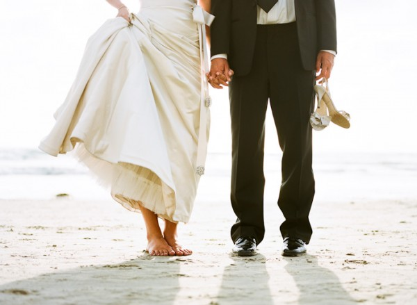 Bride and Groom Barefoot in the Sand