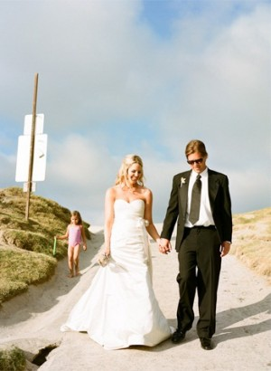 Bride and Groom Walking towards the Beach