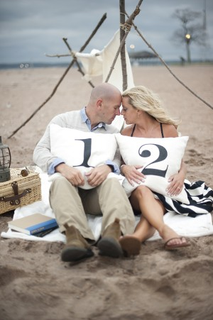 Engagement Photo with Numbered Pillows on the Beach