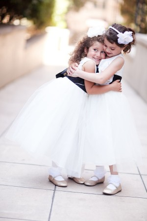 Flower Girls in White Dresses with Black Sash