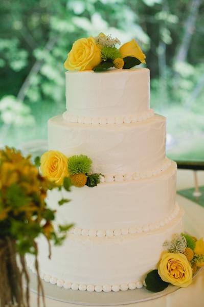 Four tier round wedding cake with yellow flowers elizabeth anne four tier round wedding cake with yellow flowers mightylinksfo