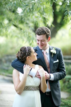 Groom Hugging Bride Outdoors