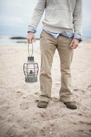 Male Holding Lantern on the Beach