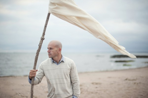 Male with Flag on the Beach