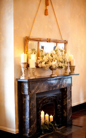 Reception Flowers and Candles Over Fireplace