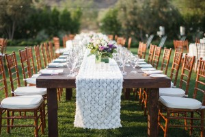 Rustic Outdoor Reception Table With Lace Runner