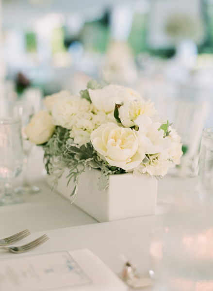White and cream flowers in wooden box centerpiece