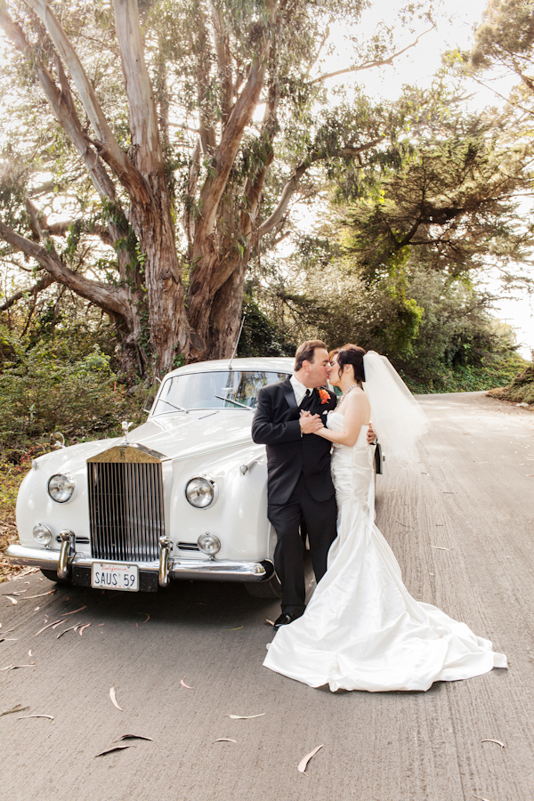 Bride and Groom With White Rolls Royce 1