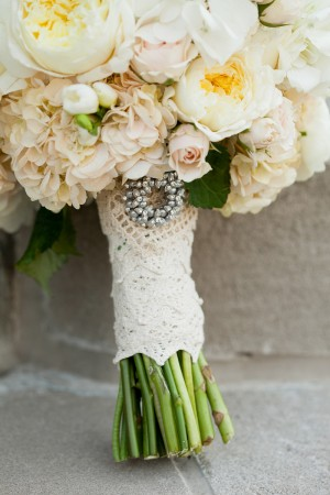 Brides Bouquet With Brooch and Lace Wrap