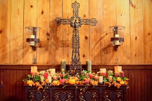 Fall Altar Arrangement With Flowers Candles and Pumpkins