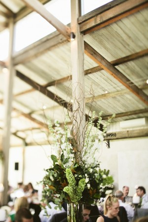 Green and White Reception Arrangement With Twigs