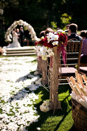 Jewel Tone Floral Aisle Decor With Branch Detail