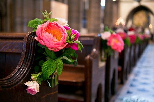Lush Pink Flower Markers on Church Pews