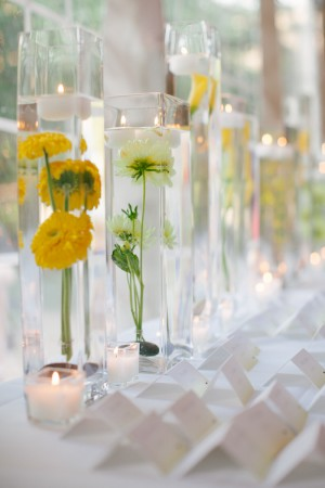Place Card Table With Yellow Flowers and Tall Glass Vases