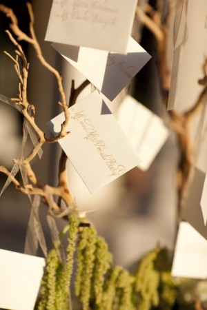 Reception Place Cards on Branches With Moss