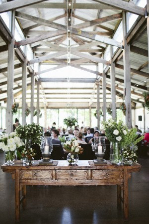 Reception Table With White and Green Arrangements