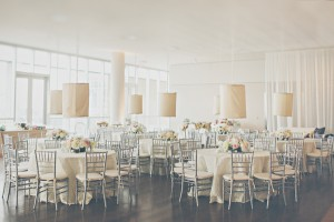 Round Reception Tables With Fabric Lanterns and Gray Bamboo Chairs 1