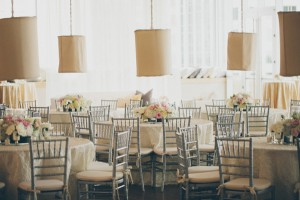 Round Reception Tables With Fabric Lanterns and Gray Bamboo Chairs