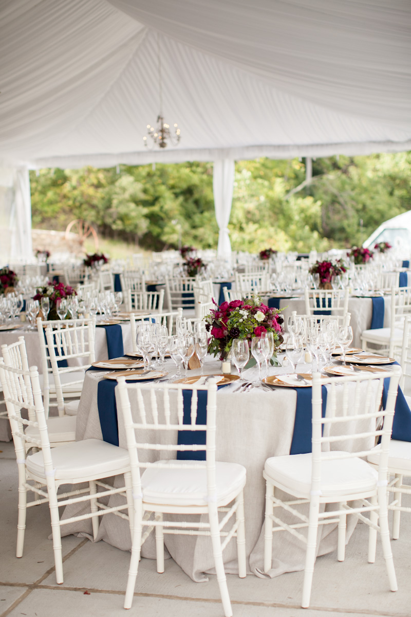 Round White Reception Tables With Blue Napkins