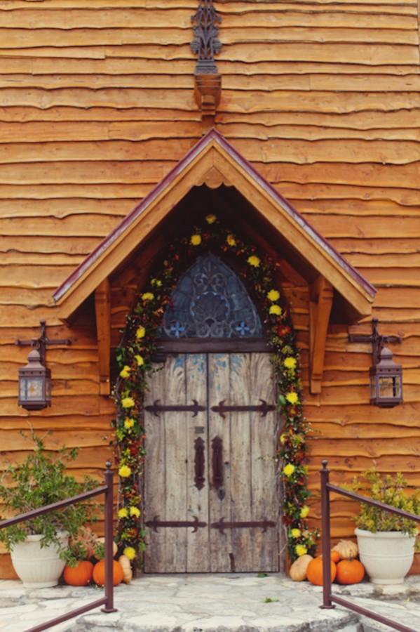 Rustic Chapel Door With Fall Garland and Pumpkins