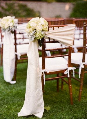 Silk Wrap on Ceremony Chairs With Rose and Hydrangea Bouquet