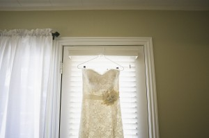 Strapless Lace Covered Bridal Gown With Ribbon and Flower Sash