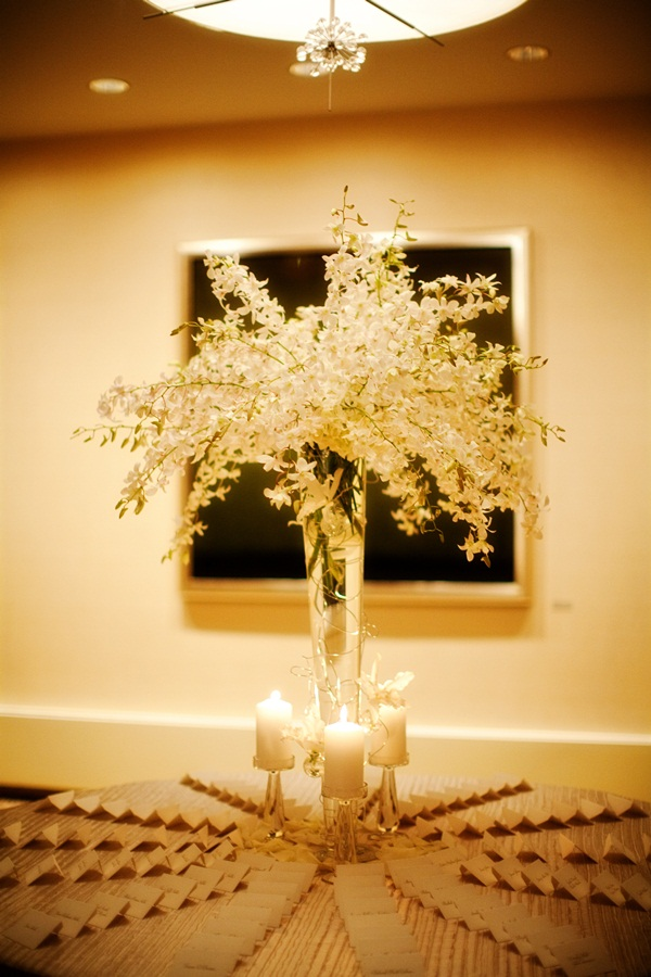 Tall White Floral Arrangement With Candles and Place Cards