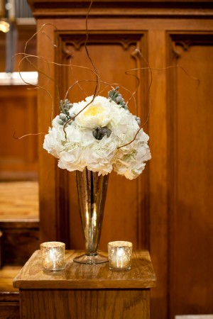 White Flowers With Gray Berries and Twigs in Mercury Glass Vase