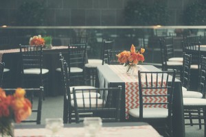 Black Reception Tables With Orange Chevron Striped Runners 1