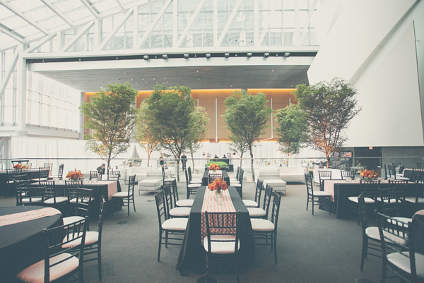 Black Reception Tables With Orange Chevron Striped Runners
