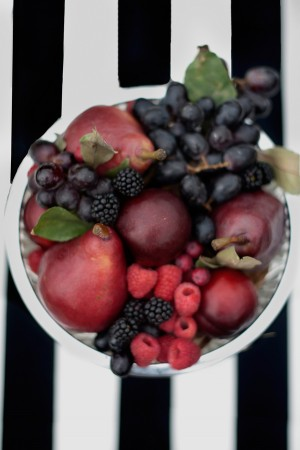 Bowl of Berries on Black and White Striped Tablecloth