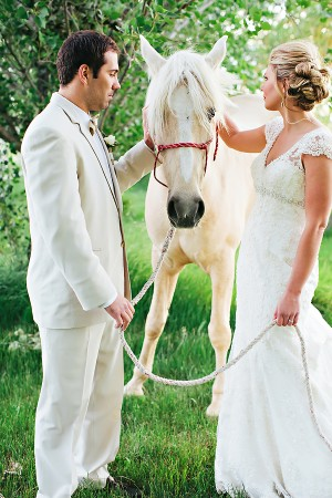 Bride and Groom in Meadow With White Horse1