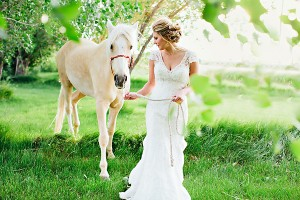 Bride in Cap Sleeve Lace Gown Walking White Horse1