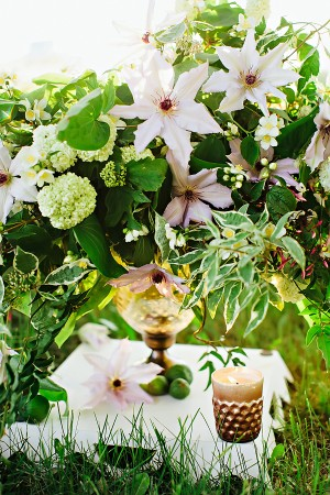 Cascading Green and White Arrangement in Amber Colored Vase1