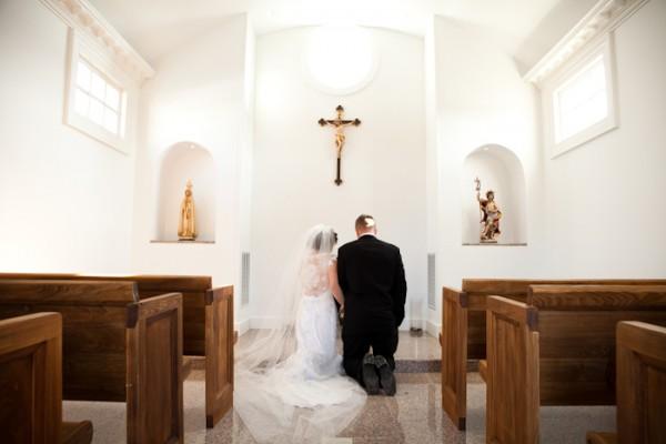 Couple Kneeling in Chapel