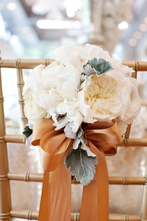 Floral Chair Decor With Brown Ribbon Bow