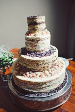 Four Tier Round Wedding Cake on Silver Stand