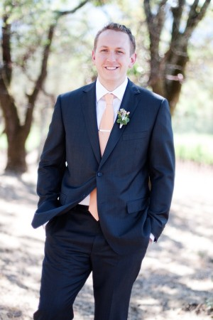 Gray Suit With Salmon Colored Tie