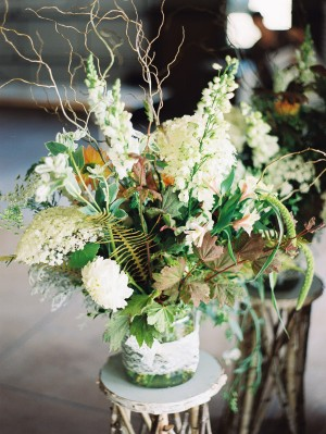 Green and White Arrangement in Glass Jar With Lace
