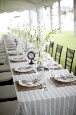 Harborside Rehearsal Dinner Table With Striped Tablecloth