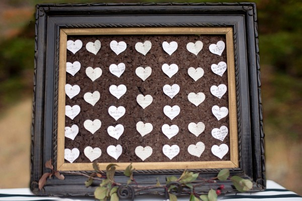 Paper Hearts With Marriage Wishes on Framed Corkboard